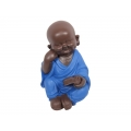 Boy Buddha Sitting in Blue Robe