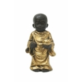 Boy Monk Meditating in Gold Robe